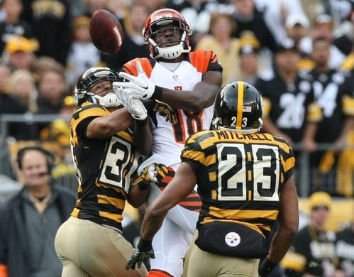 Nov 1, 2015; Pittsburgh, PA, USA; Pittsburgh Steelers cornerback Ross Cockrell (31) deflects a pass intended for Cincinnati Bengals wide receiver A.J. Green (18) and was caught and intercepted by Steelers safety Mike Mitchell (23) during the second half at Heinz Field. The Bengals won the game 16-10. Mandatory Credit: Jason Bridge-USA TODAY Sports