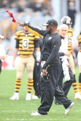 Nov 1, 2015; Pittsburgh, PA, USA; Pittsburgh Steelers head coach Mike Tomlin throws his challenge flag against the Cincinnati Bengals during the third quarter at Heinz Field. The Bengals won 16-10.Mandatory Credit: Charles LeClaire-USA TODAY Sports