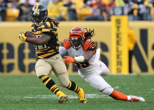 Nov 1, 2015; Pittsburgh, PA, USA; Pittsburgh Steelers running back DeAngelo Williams (34) is tackled by Cincinnati Bengals linebacker Emmanuel Lamur (59) during the second half at Heinz Field. The Bengals won the game 16-10. Mandatory Credit: Jason Bridge-USA TODAY Sports