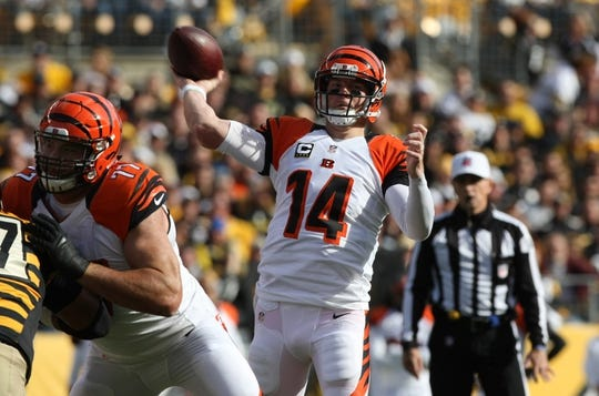Nov 1, 2015; Pittsburgh, PA, USA; Cincinnati Bengals quarterback Andy Dalton (14) throws a pass against the Pittsburgh Steelers during the first half at Heinz Field. Mandatory Credit: Jason Bridge-USA TODAY Sports