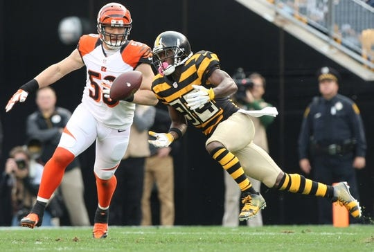 Nov 1, 2015; Pittsburgh, PA, USA; Pittsburgh Steelers wide receiver Antonio Brown (84) drops a pass in front of Cincinnati Bengals linebacker A.J. Hawk (50) during the second half at Heinz Field. The Bengals won the game 16-10. Mandatory Credit: Jason Bridge-USA TODAY Sports