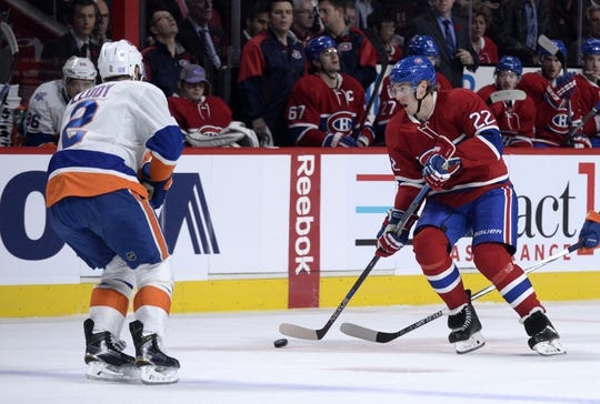 Nov 5, 2015; Montreal, Quebec, CAN; Montreal Canadiens forward Dale Weise (22) plays the puck and New York Islanders defenseman Nick Leddy (2) defends during the first period at the Bell Centre. Mandatory Credit: Eric Bolte-USA TODAY Sports