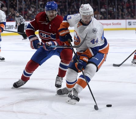 Nov 5, 2015; Montreal, Quebec, CAN; New York Islanders defenseman Calvin de Haan (44) takes the puck away from Montreal Canadiens forward Max Pacioretty (67) during the first period at the Bell Centre. Mandatory Credit: Eric Bolte-USA TODAY Sports