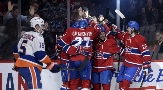 Nov 5, 2015; Montreal, Quebec, CAN; Montreal Canadiens forward Dale Weise (22) is surrounded by teammates including Alex Galchenyuk (27) and David Desharnais (51) and Jeff Petry (26) after scoring a goal against the New York Islanders during the first period at the Bell Centre. Mandatory Credit: Eric Bolte-USA TODAY Sports