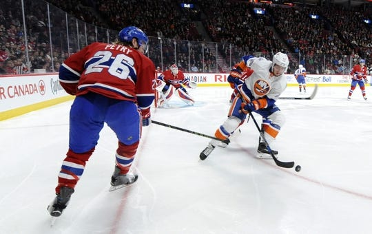 Nov 5, 2015; Montreal, Quebec, CAN; New York Islanders defenseman Marek Zidlicky (28) plays the pucks and Montreal Canadiens defenseman Jeff Petry (26) defends during the second period at the Bell Centre. Mandatory Credit: Eric Bolte-USA TODAY Sports