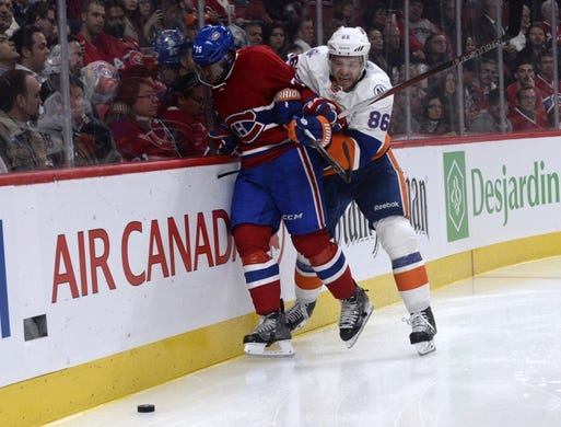 Nov 5, 2015; Montreal, Quebec, CAN; New York Islanders forward Nikolay Kulemin (86) separates Montreal Canadiens defenseman P.K. Subban (76) from the puck during the second period at the Bell Centre. Mandatory Credit: Eric Bolte-USA TODAY Sports