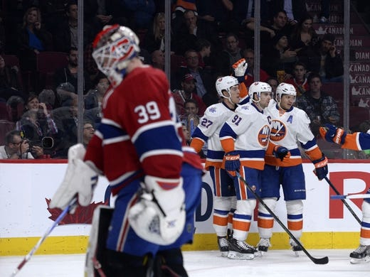 Nov 5, 2015; Montreal, Quebec, CAN; New York Islanders forward Kyle Okposo (21) celebrates with teammates including John Tavares (91) and Anders Lee (27) after scoring a goal against Montreal Canadiens goalie Mike Condon (39) during the second period at the Bell Centre. Mandatory Credit: Eric Bolte-USA TODAY Sports