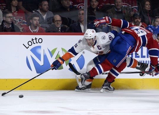 Nov 5, 2015; Montreal, Quebec, CAN; New York Islanders forward John Tavares (91) moves the puck by Montreal Canadiens defenseman Andrei Markov (79) during the second period at the Bell Centre. Mandatory Credit: Eric Bolte-USA TODAY Sports