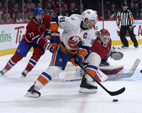 Nov 5, 2015; Montreal, Quebec, CAN; New York Islanders forward John Tavares (91) circles the net of Montreal Canadiens goalie Mike Condon (39) during the second period at the Bell Centre. Mandatory Credit: Eric Bolte-USA TODAY Sports