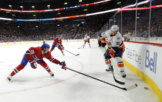 Nov 5, 2015; Montreal, Quebec, CAN; New York Islanders forward Frans Nielsen (51) plays the puck and Montreal Canadiens defenseman Jeff Petry (26) defends the pucks during the second period at the Bell Centre. Mandatory Credit: Eric Bolte-USA TODAY Sports