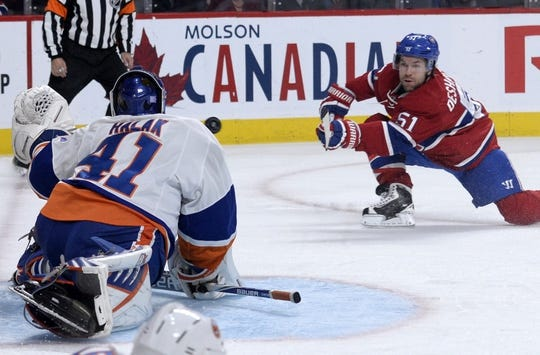 Nov 5, 2015; Montreal, Quebec, CAN; Montreal Canadiens forward David Desharnais (51) scores a goal against New York Islanders goalie Jaroslav Halak (41) during the third period at the Bell Centre. Mandatory Credit: Eric Bolte-USA TODAY Sports