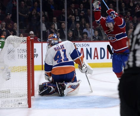 Nov 5, 2015; Montreal, Quebec, CAN; Montreal Canadiens forward Brendan Gallagher (11) scores a goal against New York Islanders goalie Jaroslav Halak (41) during the third period at the Bell Centre. Mandatory Credit: Eric Bolte-USA TODAY Sports