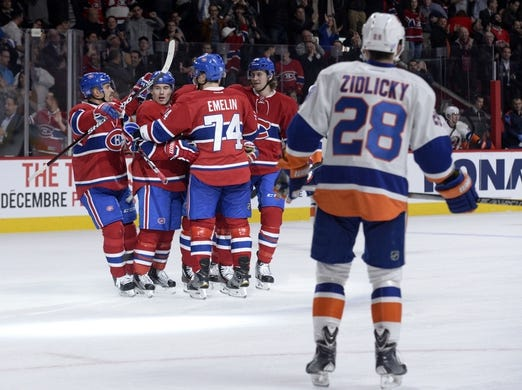 Nov 5, 2015; Montreal, Quebec, CAN; Montreal Canadiens forward Brendan Gallagher (11) celebrates with teammates including Tomas Plekanec (14) and Alexei Emelin (74) and Jeff Petry (26)after scoring a goal against the New York Islanders during the third period at the Bell Centre. Mandatory Credit: Eric Bolte-USA TODAY Sports