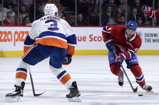 Nov 5, 2015; Montreal, Quebec, CAN; Montreal Canadiens forward Paul Byron (41) moves the puck against New York Islanders defenseman Travis Hamonic (3) during the third period at the Bell Centre. Mandatory Credit: Eric Bolte-USA TODAY Sports