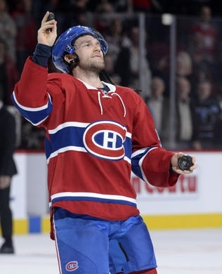 Nov 5, 2015; Montreal, Quebec, CAN; Montreal Canadiens forward David Desharnais (51) throws an autographed puck to the crowd after receiving first star of the game award against the New York Islanders at the Bell Centre. Mandatory Credit: Eric Bolte-USA TODAY Sports
