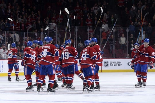 Nov 5, 2015; Montreal, Quebec, CAN;  The Montreal Canadiens celebrate their 4-1 victory over the New York Islanders at the Bell Centre. Mandatory Credit: Eric Bolte-USA TODAY Sports