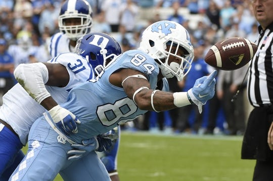 Nov 7, 2015; Chapel Hill, NC, USA; North Carolina Tar Heels wide receiver Bug Howard (84) tries to make a catch in the end zone as Duke Blue Devils cornerback Breon Borders (31) defends in the first quarter at Kenan Memorial Stadium. Mandatory Credit: Bob Donnan-USA TODAY Sports