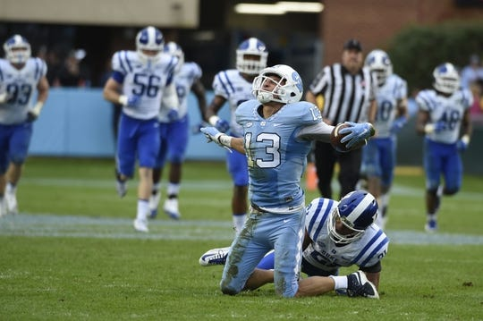 Nov 7, 2015; Chapel Hill, NC, USA; North Carolina Tar Heels wide receiver Mack Hollins (13) reacts as Duke Blue Devils cornerback Alonzo Saxton II (21) is in the background in the third quarter at Kenan Memorial Stadium. Mandatory Credit: Bob Donnan-USA TODAY Sports