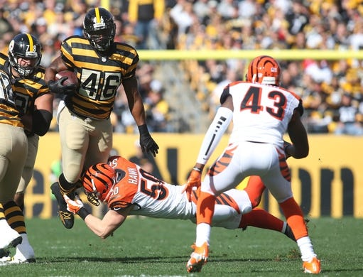 Nov 1, 2015; Pittsburgh, PA, USA; Pittsburgh Steelers fullback Will Johnson (46) carries the ball as Cincinnati Bengals outside linebacker A.J. Hawk (50) and strong safety George Iloka (43) defend during the first quarter at Heinz Field. The Bengals won 16-10. Mandatory Credit: Charles LeClaire-USA TODAY Sports