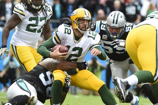 Nov 8, 2015; Charlotte, NC, USA; Green Bay Packers quarterback Aaron Rodgers (12) is sacked by Carolina Panthers defensive tackle Star Lotulelei (98) and middle linebacker Luke Kuechly (59) in the first quarter at Bank of America Stadium. Mandatory Credit: Bob Donnan-USA TODAY Sports