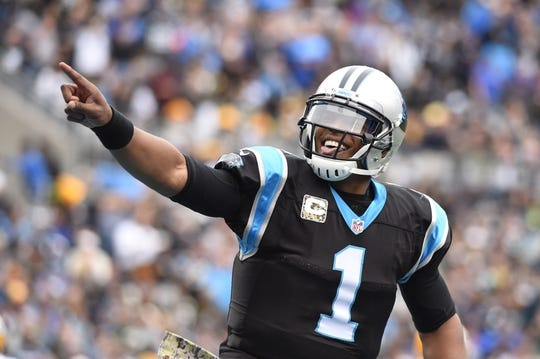 Nov 8, 2015; Charlotte, NC, USA; Carolina Panthers quarterback Cam Newton (1) reacts after touchdown in the second quarter at Bank of America Stadium. Mandatory Credit: Bob Donnan-USA TODAY Sports
