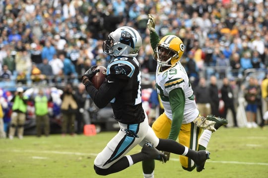 Nov 8, 2015; Charlotte, NC, USA; Carolina Panthers wide receiver Corey Brown (10) catches a touchdown as Green Bay Packers cornerback Demetri Goodson (39) defends in the second quarter at Bank of America Stadium. Mandatory Credit: Bob Donnan-USA TODAY Sports