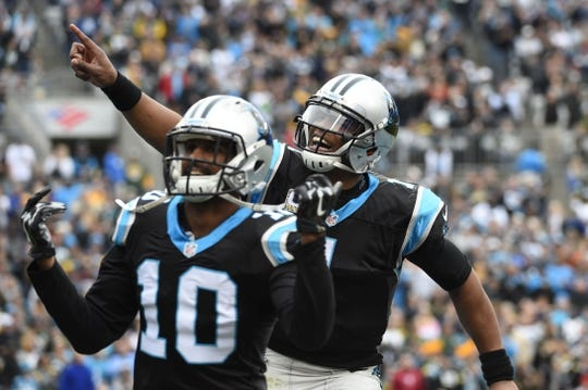 Nov 8, 2015; Charlotte, NC, USA; Carolina Panthers quarterback Cam Newton (1) celebrates after throwing a touchdown to wide receiver Corey Brown (10) in the second quarter at Bank of America Stadium. Mandatory Credit: Bob Donnan-USA TODAY Sports