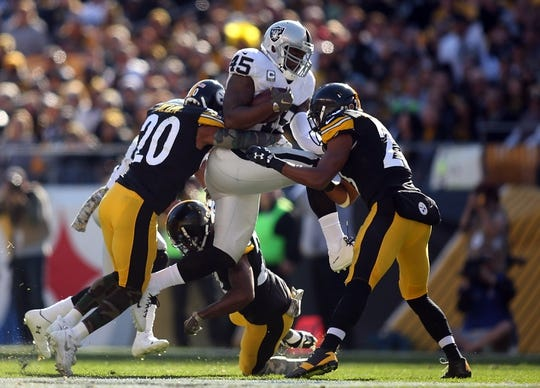 Nov 8, 2015; Pittsburgh, PA, USA; Oakland Raiders fullback Marcel Reece (45) runs with the ball as Pittsburgh Steelers strong safety Will Allen (20) and cornerback William Gay (middle) and free safety Mike Mitchell (23) defend during the first quarter during the first quarter at Heinz Field. Mandatory Credit: Charles LeClaire-USA TODAY Sports