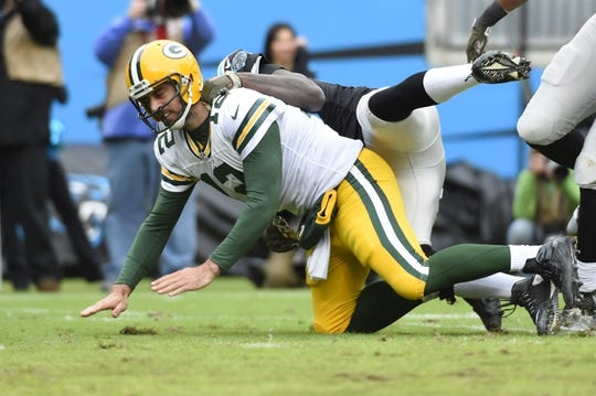 Nov 8, 2015; Charlotte, NC, USA; Green Bay Packers quarterback Aaron Rodgers (12) is pressured by Carolina Panthers outside linebacker Thomas Davis (58) in the second quarter at Bank of America Stadium. Mandatory Credit: Bob Donnan-USA TODAY Sports