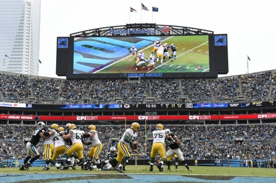 Nov 8, 2015; Charlotte, NC, USA; Green Bay Packers quarterback Aaron Rodgers (12) looks to pass in the second quarter at Bank of America Stadium. Mandatory Credit: Bob Donnan-USA TODAY Sports