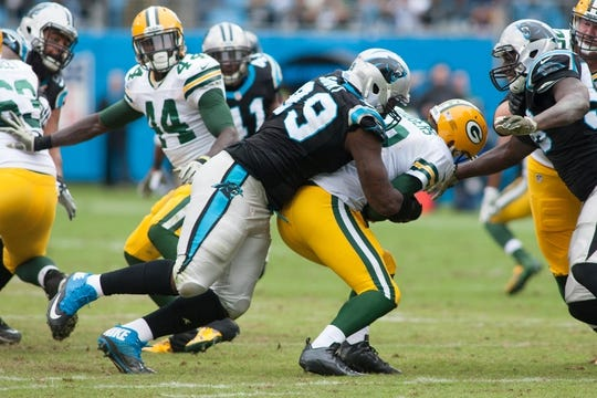 Nov 8, 2015; Charlotte, NC, USA; Carolina Panthers defensive tackle Kawann Short (99) sacks Green Bay Packers quarterback Aaron Rodgers (12) during the second quarter at Bank of America Stadium. Mandatory Credit: Jeremy Brevard-USA TODAY Sports