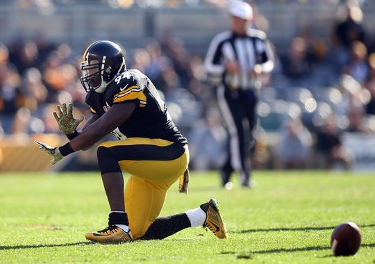 Nov 8, 2015; Pittsburgh, PA, USA; Pittsburgh Steelers inside linebacker Lawrence Timmons (94) gesture after breaking up a pass against the Oakland Raiders during the first quarter at Heinz Field. Mandatory Credit: Charles LeClaire-USA TODAY Sports