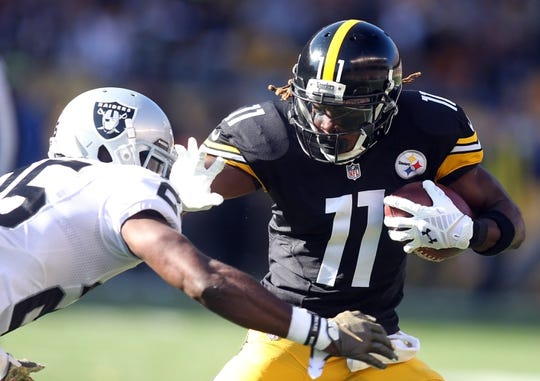 Nov 8, 2015; Pittsburgh, PA, USA; Pittsburgh Steelers wide receiver Markus Wheaton (11) runs after a catch as Oakland Raiders cornerback D.J. Hayden (25) defends during the first quarter at Heinz Field. Mandatory Credit: Charles LeClaire-USA TODAY Sports