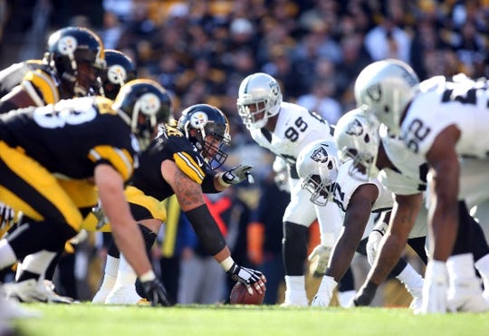 Nov 8, 2015; Pittsburgh, PA, USA; Pittsburgh Steelers center Cody Wallace (72) gestures at the line of scrimmage against the Oakland Raiders defense during the second quarter at Heinz Field. Mandatory Credit: Charles LeClaire-USA TODAY Sports