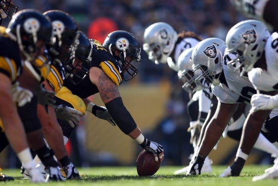 Nov 8, 2015; Pittsburgh, PA, USA; The Pittsburgh Steelers offense lines up against the Oakland Raiders defense during the second quarter at Heinz Field. Mandatory Credit: Charles LeClaire-USA TODAY Sports
