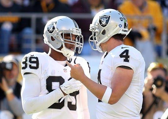 Nov 8, 2015; Pittsburgh, PA, USA; Oakland Raiders wide receiver Amari Cooper (89) and quarterback Derek Carr (4) celebrate after combining on a touchdown pass against  the Pittsburgh Steelers during the second quarter at Heinz Field. Mandatory Credit: Charles LeClaire-USA TODAY Sports