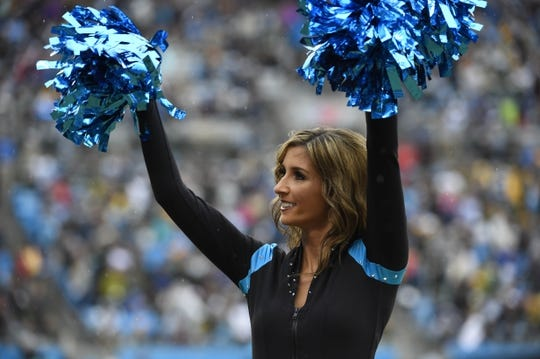 Nov 8, 2015; Charlotte, NC, USA; Carolina Panthers cheerleader performs in the fourth quarter. The Panthers defeated the Packers 37-29 at Bank of America Stadium. Mandatory Credit: Bob Donnan-USA TODAY Sports