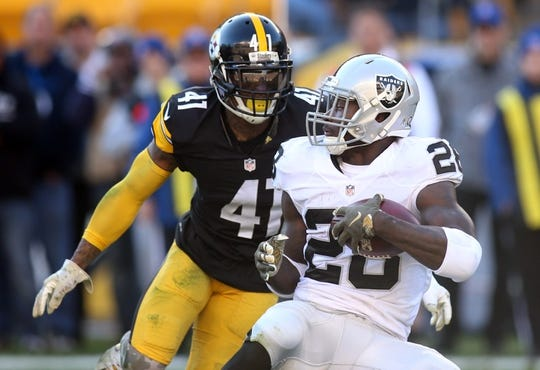 Nov 8, 2015; Pittsburgh, PA, USA; Oakland Raiders running back Latavius Murray (28) is tackled for a loss by Pittsburgh Steelers cornerback Antwon Blake (41) during the second quarter at Heinz Field. The Steelers won 38-35. Mandatory Credit: Charles LeClaire-USA TODAY Sports