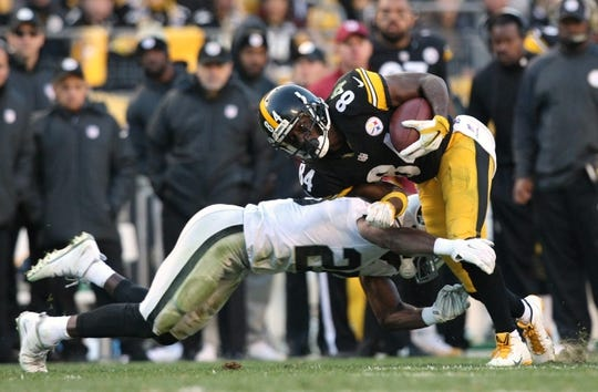 Nov 8, 2015; Pittsburgh, PA, USA; Pittsburgh Steelers wide receiver Antonio Brown (84) is hit by Oakland Raiders cornerback DJ Hayden (25) during the second half at Heinz Field. The Steelers won the game, 38-35. Mandatory Credit: Jason Bridge-USA TODAY Sports