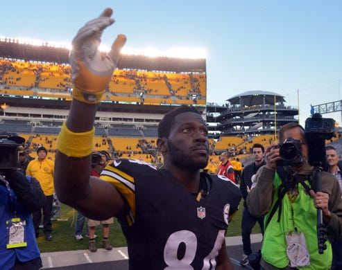 Nov 8, 2015; Pittsburgh, PA, USA; Pittsburgh Steelers receiver Antonio Brown (84) reacts after a 38-35 victory over the Oakland Raiders in a NFL football game at Heinz Field. Mandatory Credit: Kirby Lee-USA TODAY Sports