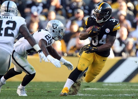 Nov 8, 2015; Pittsburgh, PA, USA; Pittsburgh Steelers running back DeAngelo Williams (34) runs the ball against Oakland Raiders cornerback DJ Hayden (25) during the second half at Heinz Field. The Steelers won the game, 38-35. Mandatory Credit: Jason Bridge-USA TODAY Sports
