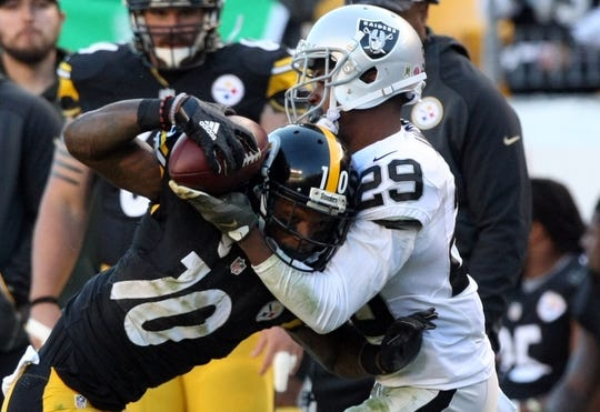 Nov 8, 2015; Pittsburgh, PA, USA; Pittsburgh Steelers wide receiver Martavis Bryant (10) is tackled by Oakland Raiders cornerback David Amerson (29) during the second half at Heinz Field. The Steelers won the game, 38-35. Mandatory Credit: Jason Bridge-USA TODAY Sports
