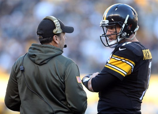Nov 8, 2015; Pittsburgh, PA, USA; Pittsburgh Steelers offensive coordinator Todd Haley (L) and quarterback Ben Roethlisberger (7) talk during a time-out against the Oakland Raiders during the third quarter at Heinz Field. The Steelers won 38-35. Mandatory Credit: Charles LeClaire-USA TODAY Sports