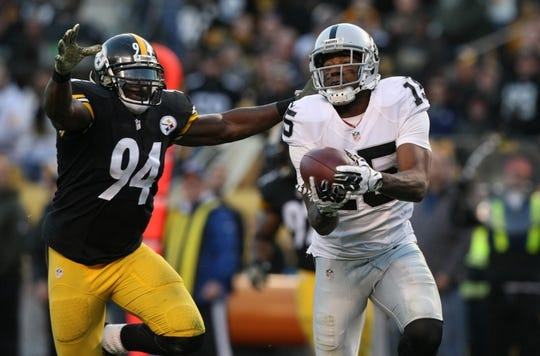 Nov 8, 2015; Pittsburgh, PA, USA; Oakland Raiders wide receiver Michael Crabtree (15) catches a pass for a touchdown past Pittsburgh Steelers linebacker Lawrence Timmons (94) during the second half at Heinz Field. The Steelers won the game, 38-35. Mandatory Credit: Jason Bridge-USA TODAY Sports
