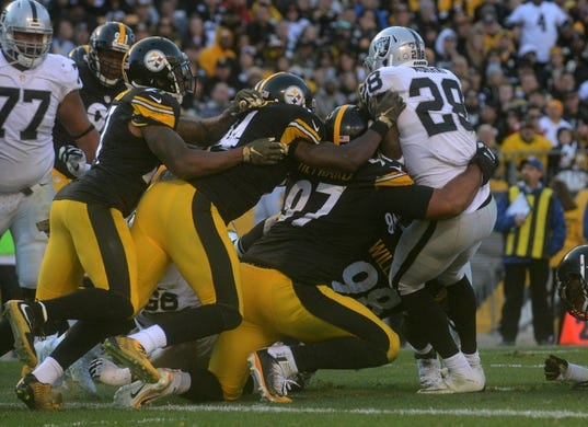Nov 8, 2015; Pittsburgh, PA, USA; The Pittsburgh Steelers defense stops Oakland Raiders running back Latavius Murray (28) during the second half at Heinz Field. The Steelers won the game, 38-35. Mandatory Credit: Jason Bridge-USA TODAY Sports