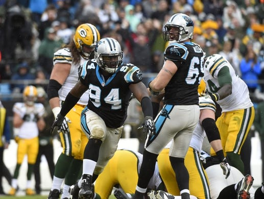 Nov 8, 2015; Charlotte, NC, USA; Carolina Panthers defensive end Kony Ealy (94) reacts with defensive end Jared Allen (69) after sacking Green Bay Packers quarterback Aaron Rodgers (12) in the fourth quarter. The Panthers defeated the Packers 37-29 at Bank of America Stadium. Mandatory Credit: Bob Donnan-USA TODAY Sports