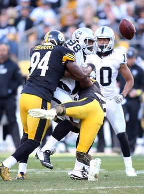 Nov 8, 2015; Pittsburgh, PA, USA; Pittsburgh Steelers inside linebacker Lawrence Timmons (94) and strong safety Will Allen (20) defend a pass intended for Oakland Raiders tight end Clive Walford (88) during the third quarter at Heinz Field. The Steelers won 38-35. Mandatory Credit: Charles LeClaire-USA TODAY Sports