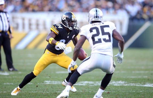 Nov 8, 2015; Pittsburgh, PA, USA; Pittsburgh Steelers wide receiver Antonio Brown (84) runs after a catch as Oakland Raiders cornerback D.J. Hayden (25) defends during the fourth quarter at Heinz Field. The Steelers won 38-35. Mandatory Credit: Charles LeClaire-USA TODAY Sports