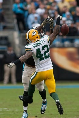 Nov 8, 2015; Charlotte, NC, USA; Green Bay Packers strong safety Morgan Burnett (42) breaks up a pass intended for Carolina Panthers wide receiver Jerricho Cotchery (82) during the third quarter at Bank of America Stadium. The Panthers defeated the Packers 37-29. Mandatory Credit: Jeremy Brevard-USA TODAY Sports