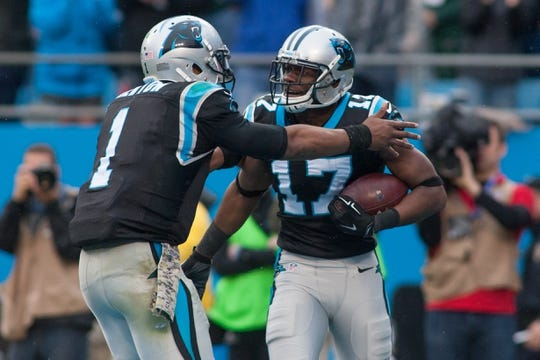 Nov 8, 2015; Charlotte, NC, USA; Carolina Panthers wide receiver Devin Funchess (17) celebrates with quarterback Cam Newton (1) during the third quarter against the Green Bay Packers at Bank of America Stadium. The Panthers defeated the Packers 37-29. Mandatory Credit: Jeremy Brevard-USA TODAY Sports